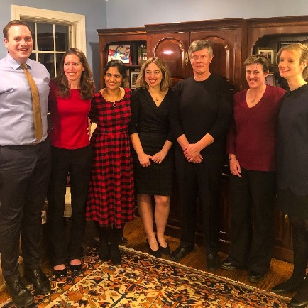 The uveitis departament Faculty and Fellows enjoying a Holiday Party at the residence of Dr. Jabs. From left to right: Dr. Chaon, Dr. Burkholder, Dr. Mopuru, Dr. Liberman, Dr. Jabs, Dr. Thorne, Dr. Berkenstock.